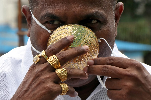 Shankar Kurhade (48), wears his face mask made out of gold as he poses for a photograph amidst the spread of the coronavirus disease (COVID-19) in Pune, India, July 4, 2020. Kurhade claims the mask weighs 50 grams and costs around $3870. REUTERS/Stringer NO ARCHIVES. NO RESALES.     TPX IMAGES OF THE DAY